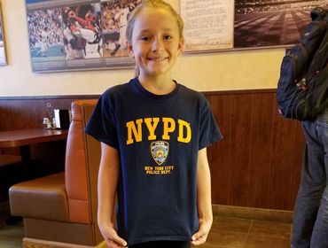 A little girl wearning the New York Police Dept shirt at our Huntington Beach restaurant