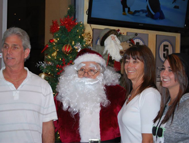Another happy family posing for picture with Santa Claus at our Huntington Beach restaurant