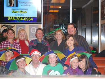 Happy family enjoy X-mas party at our Huntington Beach restaurant