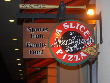 Our Huntington Beach restaurant Building sign displaying the name A Slice of New York Pizza