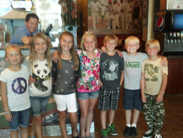 Kids posing for a group photo picture at our Huntington Beach restaurant