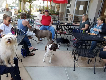 Customers seating at outside patio of our Huntington Beach restaurant enjoying themselves