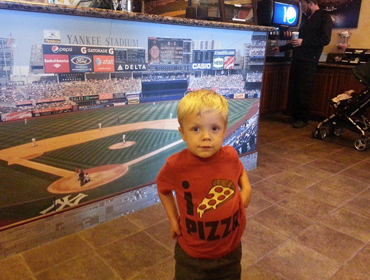 Little boy posing for picture at our Huntington Beach restaurant