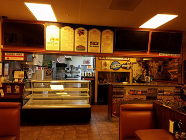 Inside view of our Huntington Beach restaurant, facing front counter