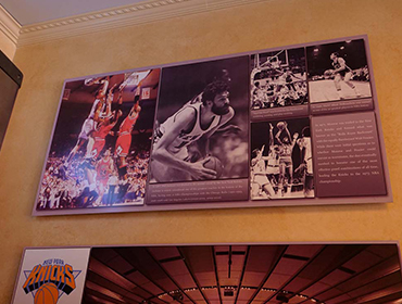 Picture of famous Basketball players hung on the wall