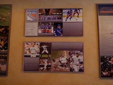 Picture of famous Hockey and Baseball players hung on the wall