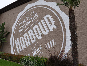 Painted sign outside of our Huntington Beach restaurant wall Dock #1 huntington harbour place