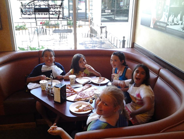 Kids enjoying their Best Slice of Newyork Pizza at our Huntington Beach restaurant
