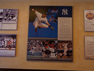 Picture of Calendar hanging on the wall with photo of World Series basbell game