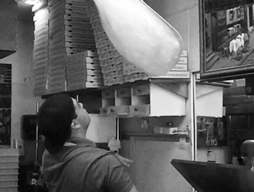 Our Chef toussing pizza dough in the air