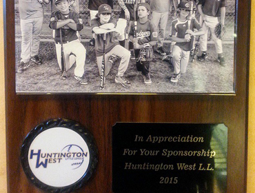 Award showing Black and White picture of local kids Baseball team recognized as the winner in 2015 sponsered by our Huntington Beach location.