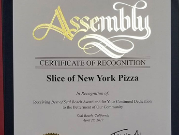 certificate of recognition presented to Slice of New York Pizza useal beach location in recogination of continued dedication to the battermet of our community