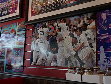 Our Seal Beach restaurant filled with sports memorabilia hanging from the walls