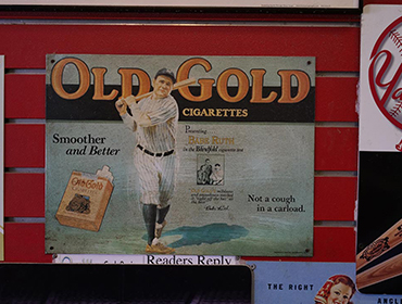 Poster of old Gold Cigarettes with Baseball payer hanging on the wall of our Seal Beach restaurant