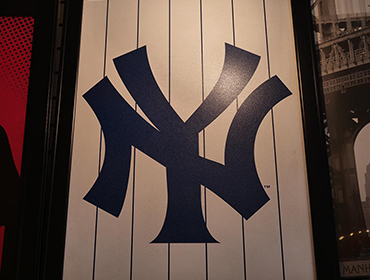 Picture frame displaying NY Yankee's uniform hanging from the wall of our Seal Beach restaurant