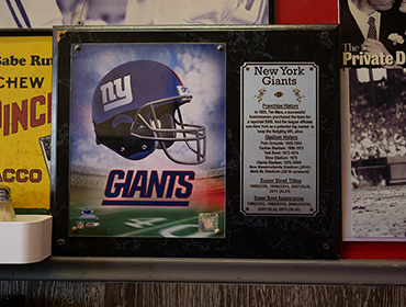 New York Giants picture hanging from the wall