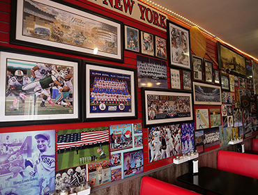 Our Seal Beach restaurant filled with many sports memorabilia hanging from the wall